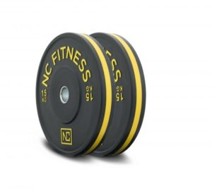 Black rubber gym bumper weight plates yellow