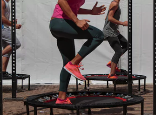 two women using a jumpsport fitness trampoline