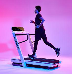 Man running on Omega Z Treadmill