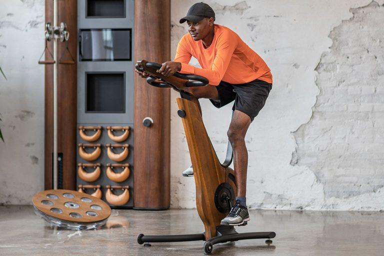 Man exercising on NOHrD exercise bike