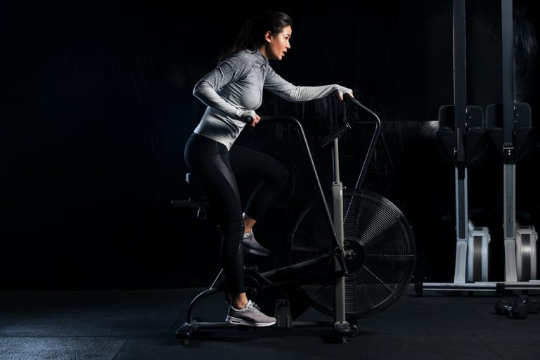 Woman exercising on fitness spin bike